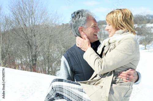 Portrait of happy senior couple in winter season - 77691774