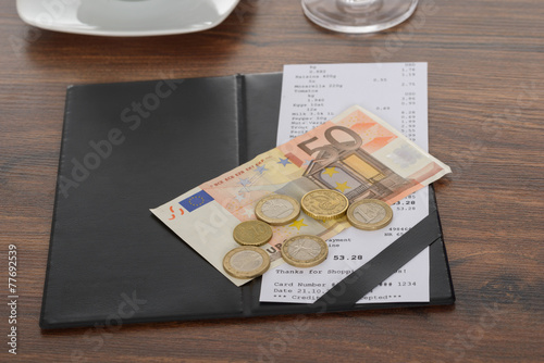 Bill With Euro Note On Table - 77692539