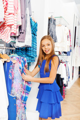 Blond girl with long hair during shopping