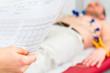 Leinwandbild Motiv Patient bei EKG in Arztpraxis
