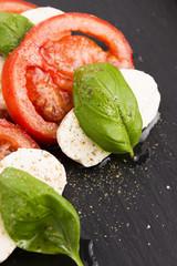 Caprese salad with mozzarella, tomato, basil and balsamic vinega