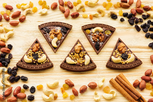 Dessert chocolate pizza with raisins and nuts - 77697588