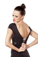 Nervous pretty woman, unzipping her tight dress