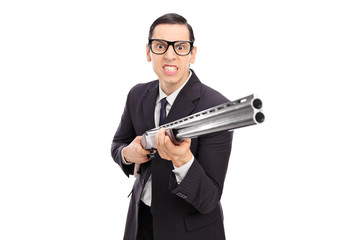 Angry businessman holding a shotgun