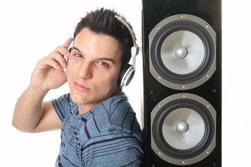 Portrait of a smiling male with headphones posing isolated on