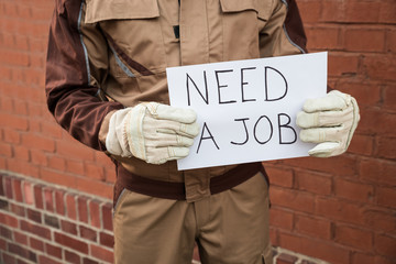 Worker Holding Placard With The Text Need A Job