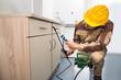 Pest Control Worker Spraying Pesticides - 77699106