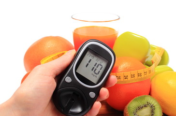 Glucometer, fruits, dumbbells, tape measure and glass of juice