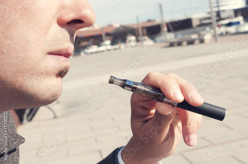 vaping with an electronic cigarette - 77700512