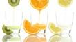 Juice orange lemon kiwi poured into glass