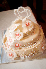Wedding cake with hearts on top