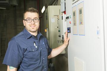 repairman engineer control panel valve equipment in a boiler
