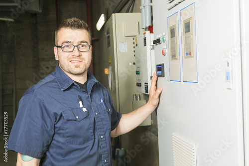 repairman engineer control panel valve equipment in a boiler - 77703529