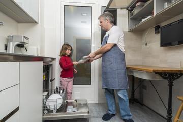 Family emptying the dishwasher
