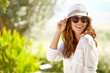 Smiling summer woman with hat and sunglasses - 77705363