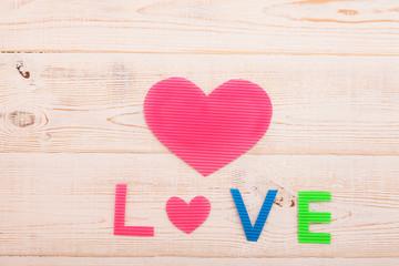 Word love on wooden background. Valentines day