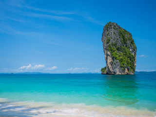 Clear water and blue sky. Beach in Krabi province.
