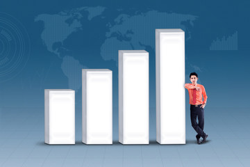 Business manager standing next to bar chart