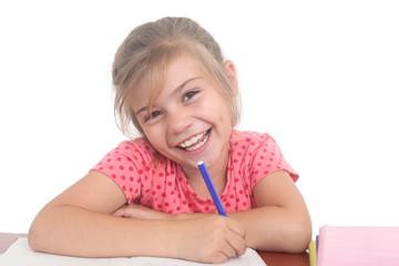 happy little girl doing homework
