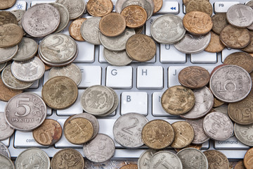coins on a keyboard