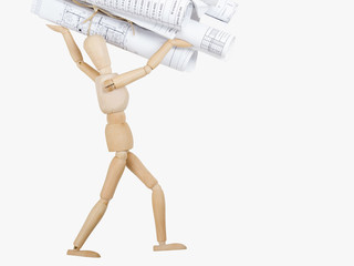 Wooden Mannequin holds blueprints