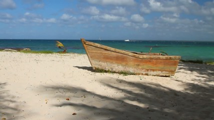Old boat on seashore. Isla Saona, La Romana, Dominican Republic