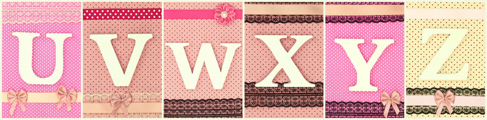 Wooden letters U V W X Y Z on polka dots background