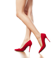 pretty female legs in red high heels walking