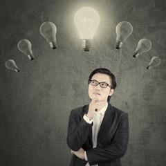 Chinese manager under lightbulb