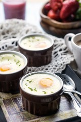 Shirred baked eggs for breakfast