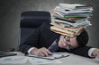 Leinwanddruck Bild - Exhausted man sleeping with paperwork