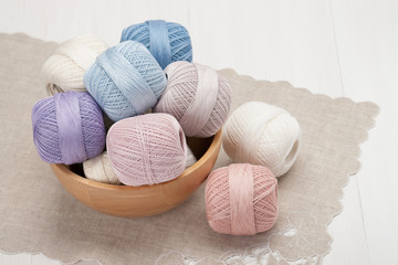 Thread Bobbins in a Wooden Bowl. Natural Linen Napkin with Croch