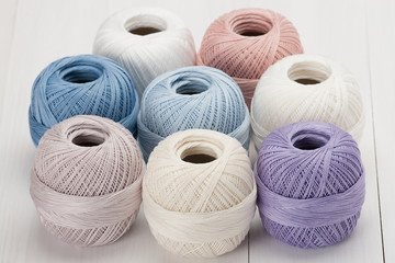 Set Of Cotton Crocheting Thread Bobbins on Wooden Table