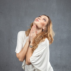 Pretty model with praying hands