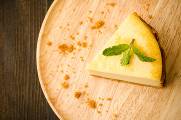 New York cheese cake on wooden plate