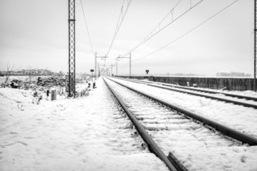 Country railroad, winter landscape with snow. BW photo