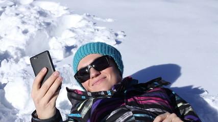 Cheerful girl taking self portrait using a smartphone