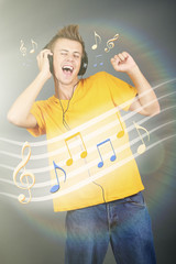 Young man with headphones listening music on bright background