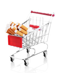 Cigarettes in shopping cart isolated on white