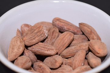 Salted and roasted almonds.