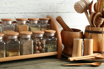Different spices in glass bottles