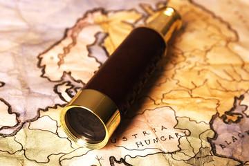 Spyglass on world map background