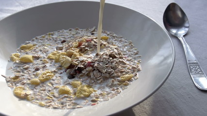 Milk is Poured Into Muesli