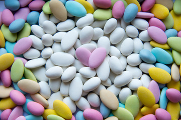 Background of sugared almonds of different colors