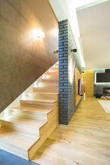 Wooden staricase inside designed apartment