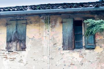 Rusty windows in old Italian farmhouse