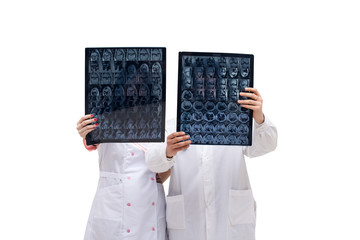 Doctors holding tomograms in front of them