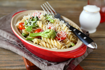 Pasta with vegetables and cheese in baking dish