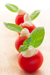 Cherry tomatoes with soft cheese
