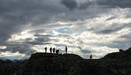People on the top of the rocks